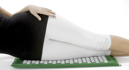 Acupressure mat used on hip and thighs