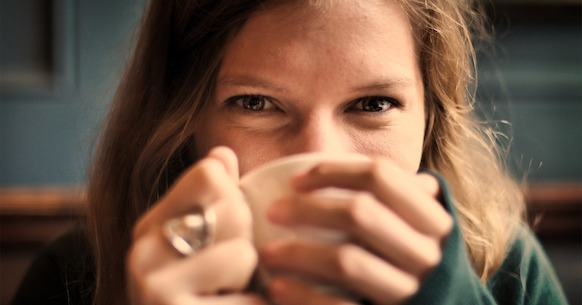 Happy woman with herbal tea